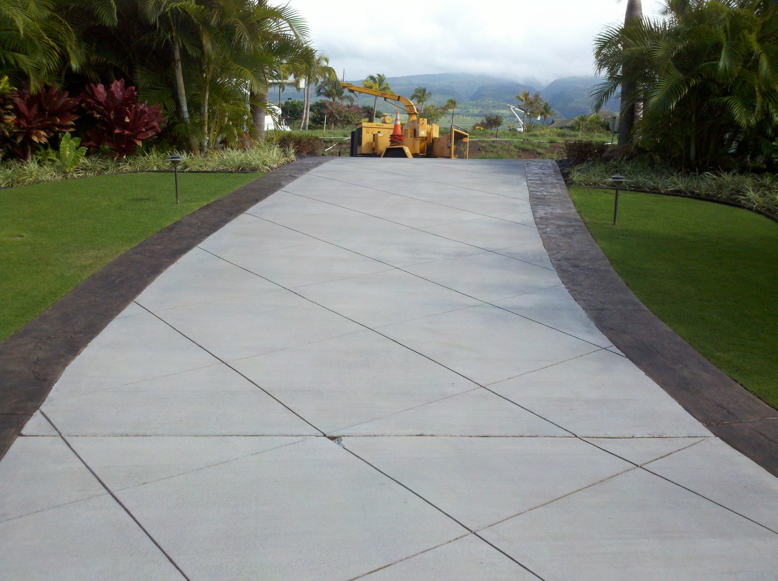 Gray Concrete Driveway with Stamped Border in lanikeha, kaanapali