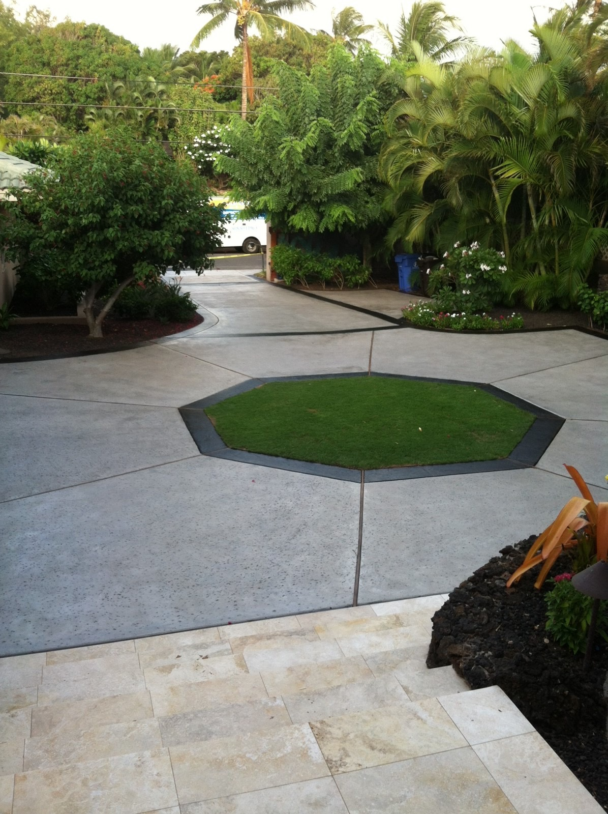 Natural gray concrete driveway with stained border