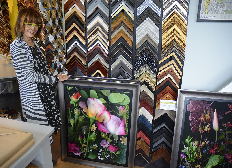 Joanne Rollins with framed work. 2016