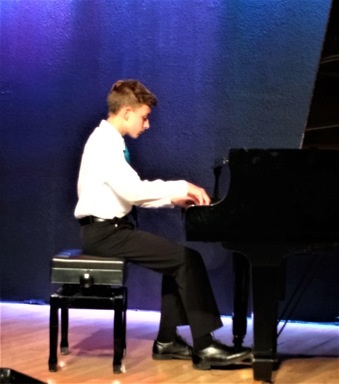 Photo, Daniel playing at Piano recital.jpg