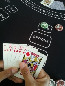 Player views and evaluates their hand