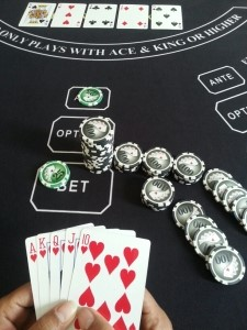 Player achieves Royal Flush, Dealer Qualifies and Player is paid 100-1 on their $50 BET = $5,000
