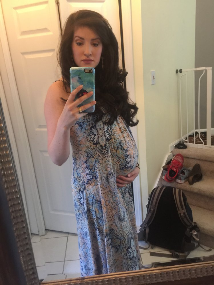 This is actually the dress I wore in my engagement pictures and it still fits great in my third trimester excuse the mess in the background! Real life is happening!