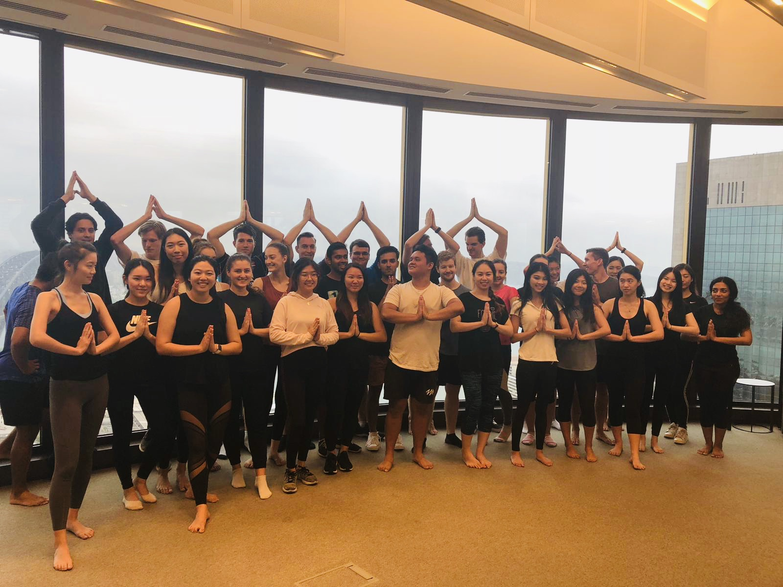 Teaching yoga to vacationers at EY, Sydney. January 2019.