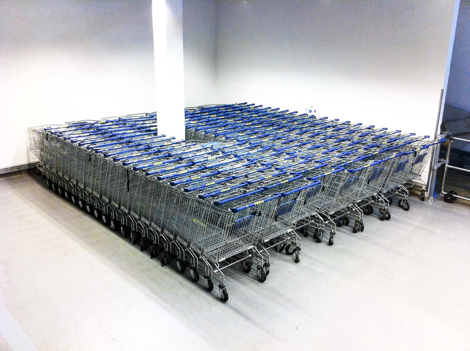 Diamond of Shopping Carts - 2011  In 2011 I started doing deliberate anonymous sculptures everywhere I went. Eventually such practice turned into a habit which I continued to record with my phone camera hoping to start an indirect conversation with stranger passerby. In 2013 I realized I was consistent with that idea and that it could turn into a real project, which is now SYMBOLS, both the project and the book.