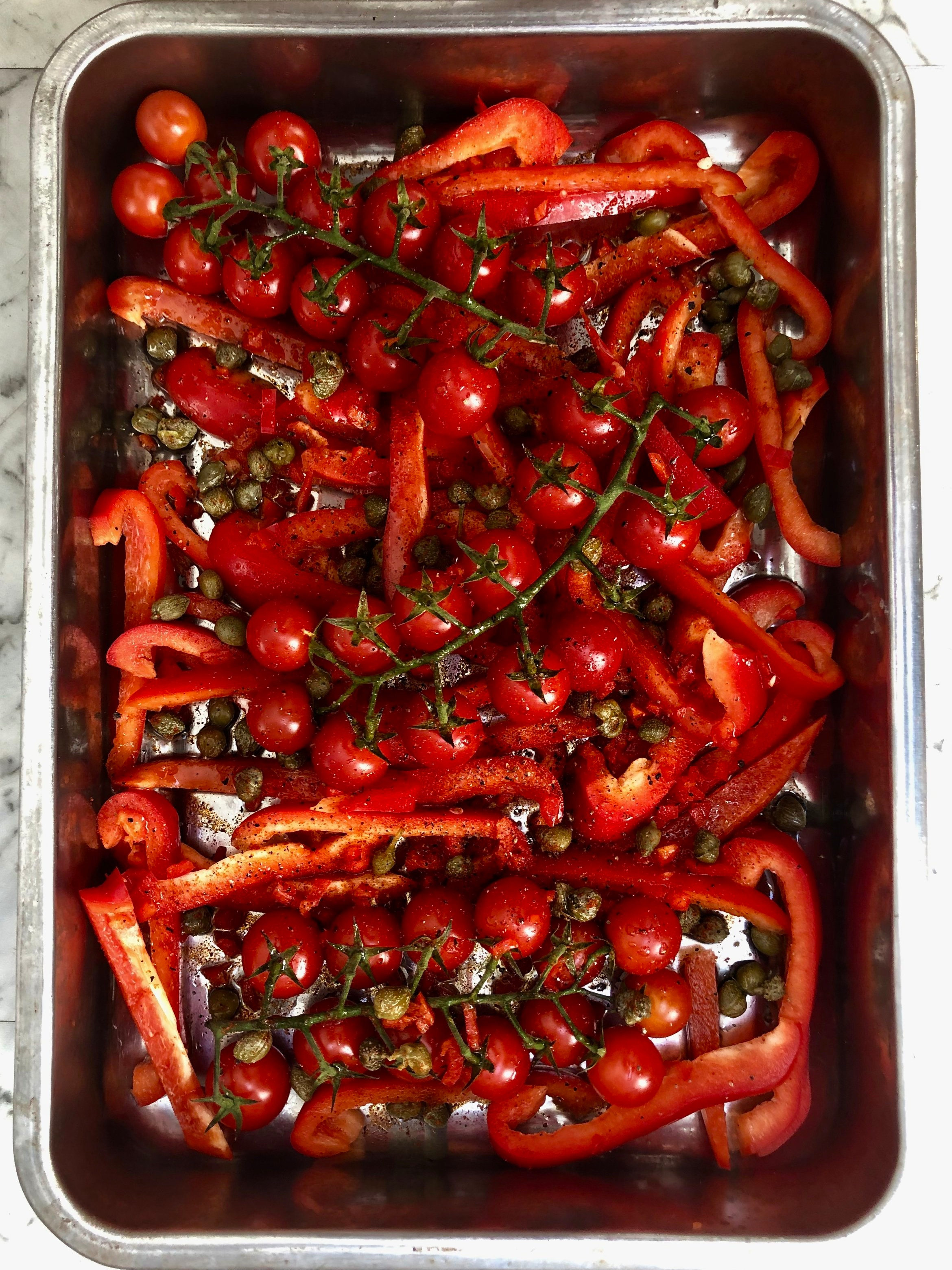 Tomatoes, pepper slices, capers, chopped chilli and paprika