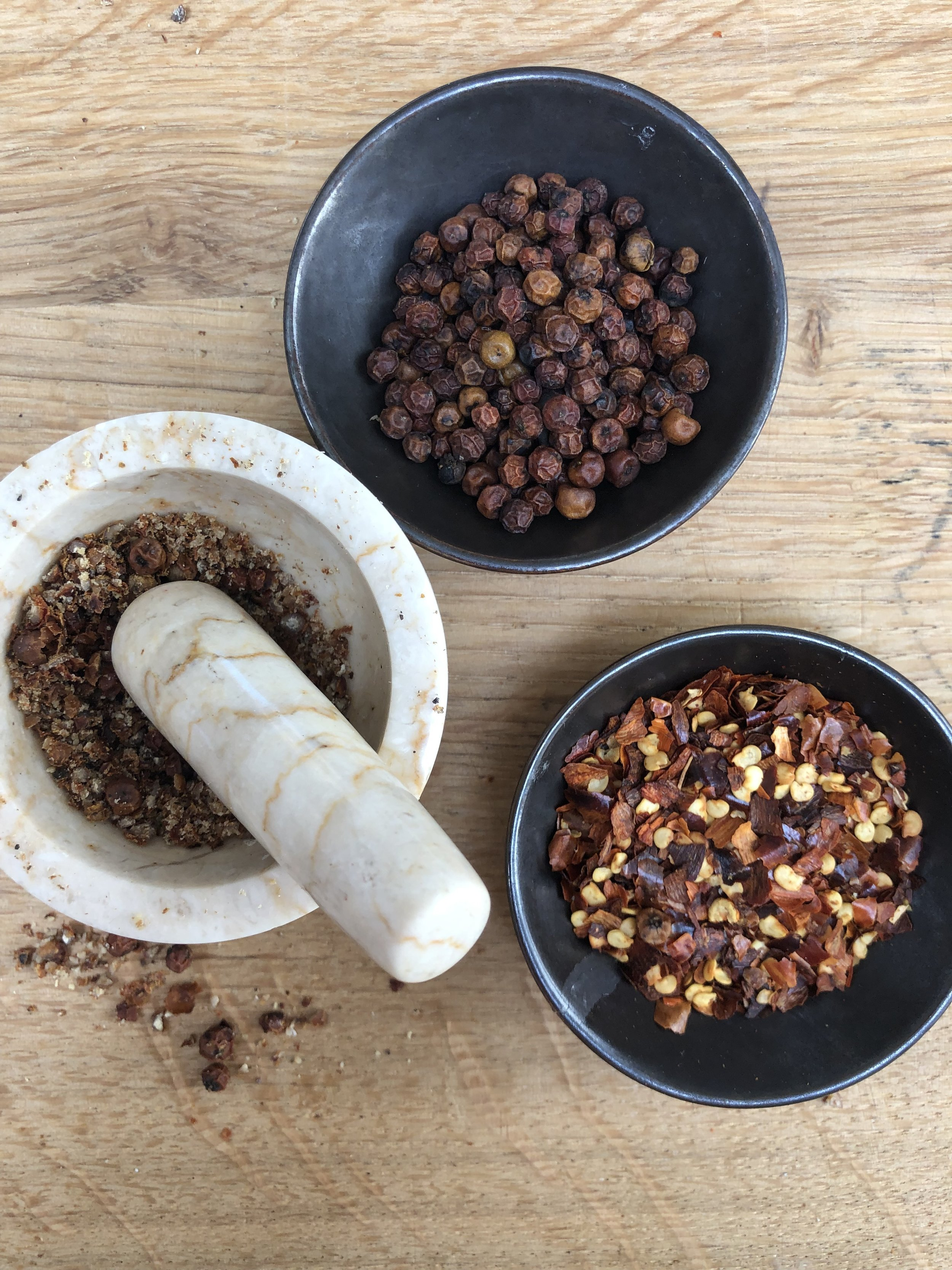 Red Kampot peppercorns and dried chilli flakes