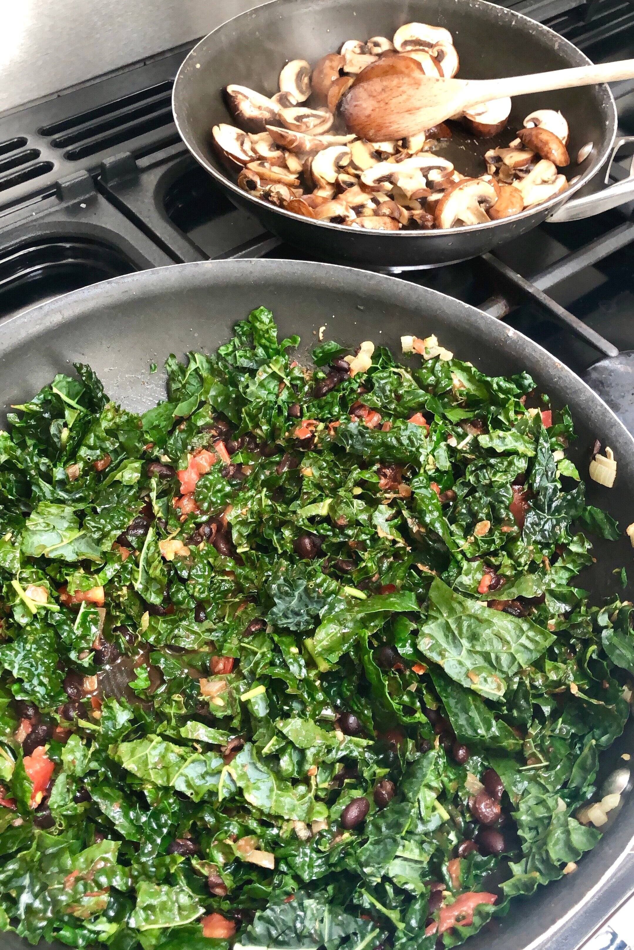 Add the greens to the beans and cook your mushrooms