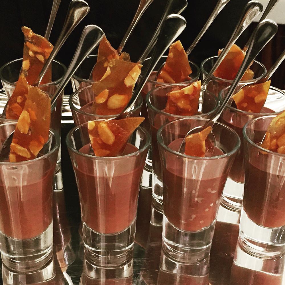 Dark and decadent chocolate shots w Marcona almond caraque
