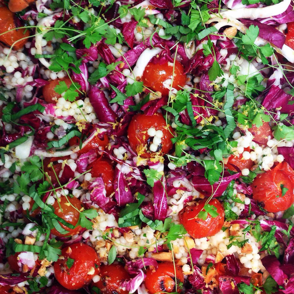 Giant couscous, blistered cherry tomatoes, radicchio and soft herbs