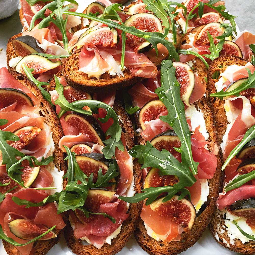 Classic Parma ham, fig, rocket and saba crostini