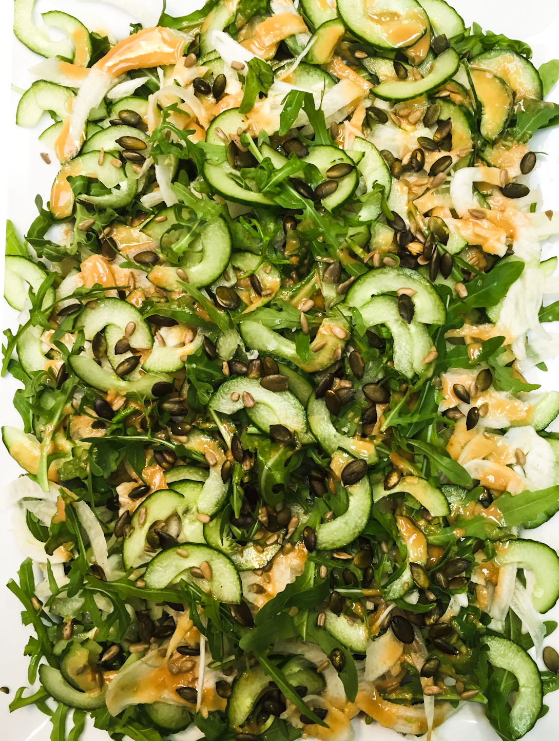 A tangle of fennel, avocado and cucumber w tahini-ginger dressing