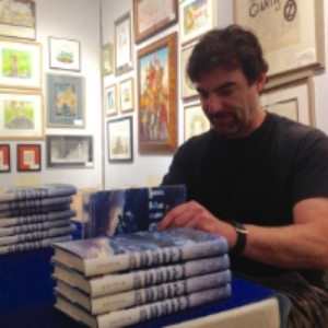 Paul signing copies of  Adrift  in Books of Wonder in NYC (summer 2015)