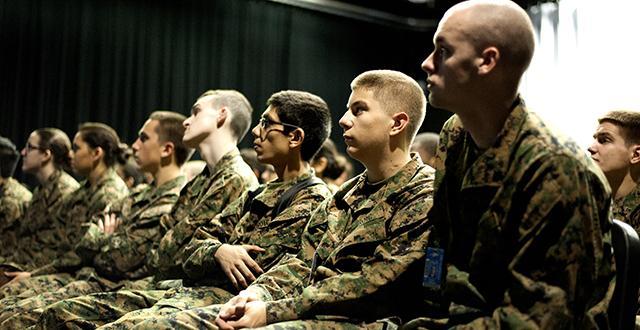 JROTC students listening to veterans speak.