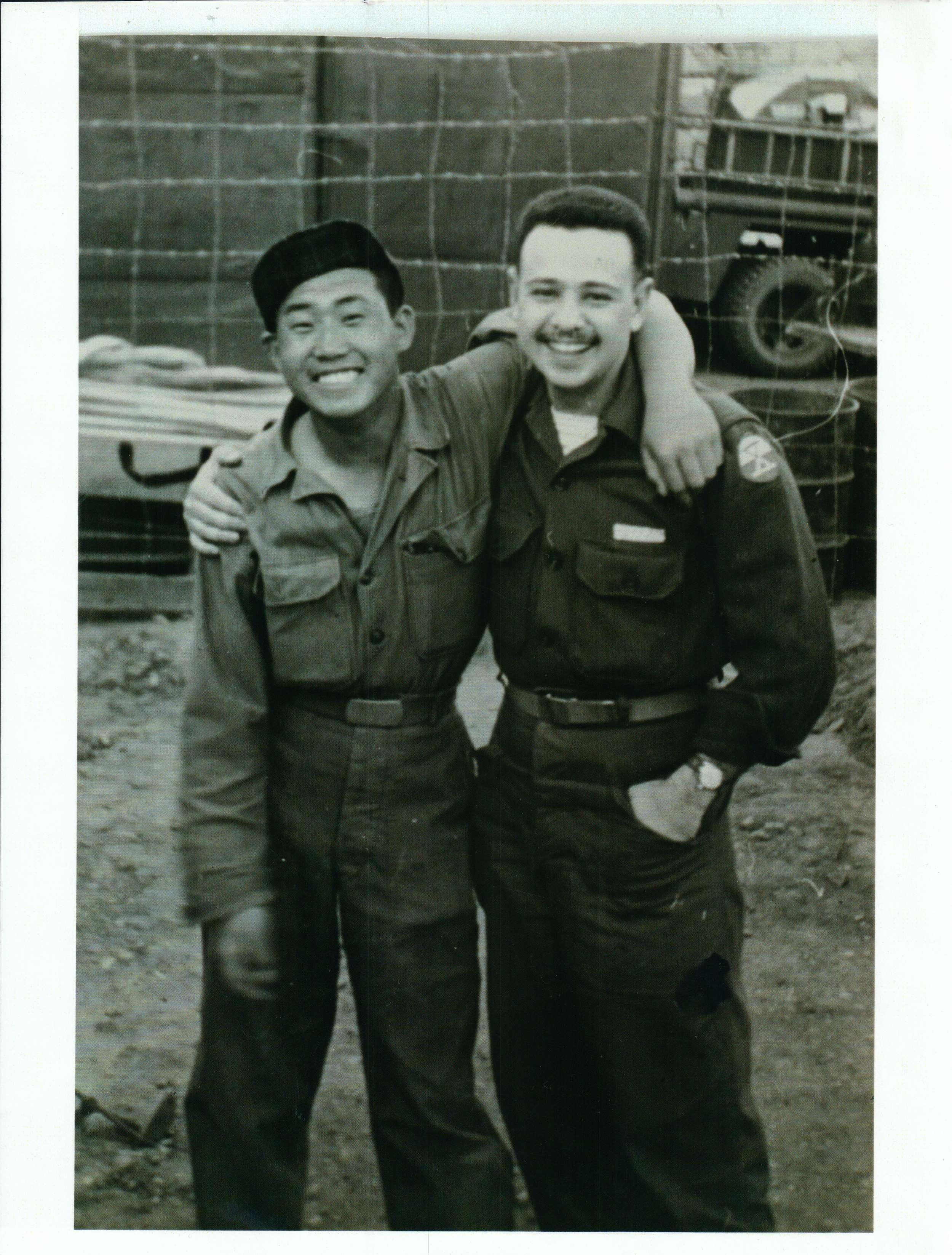 "Thomas Nuzzo with ""tent boy"" Chang Bin Han. For more photos click on the picture to go to the archive."