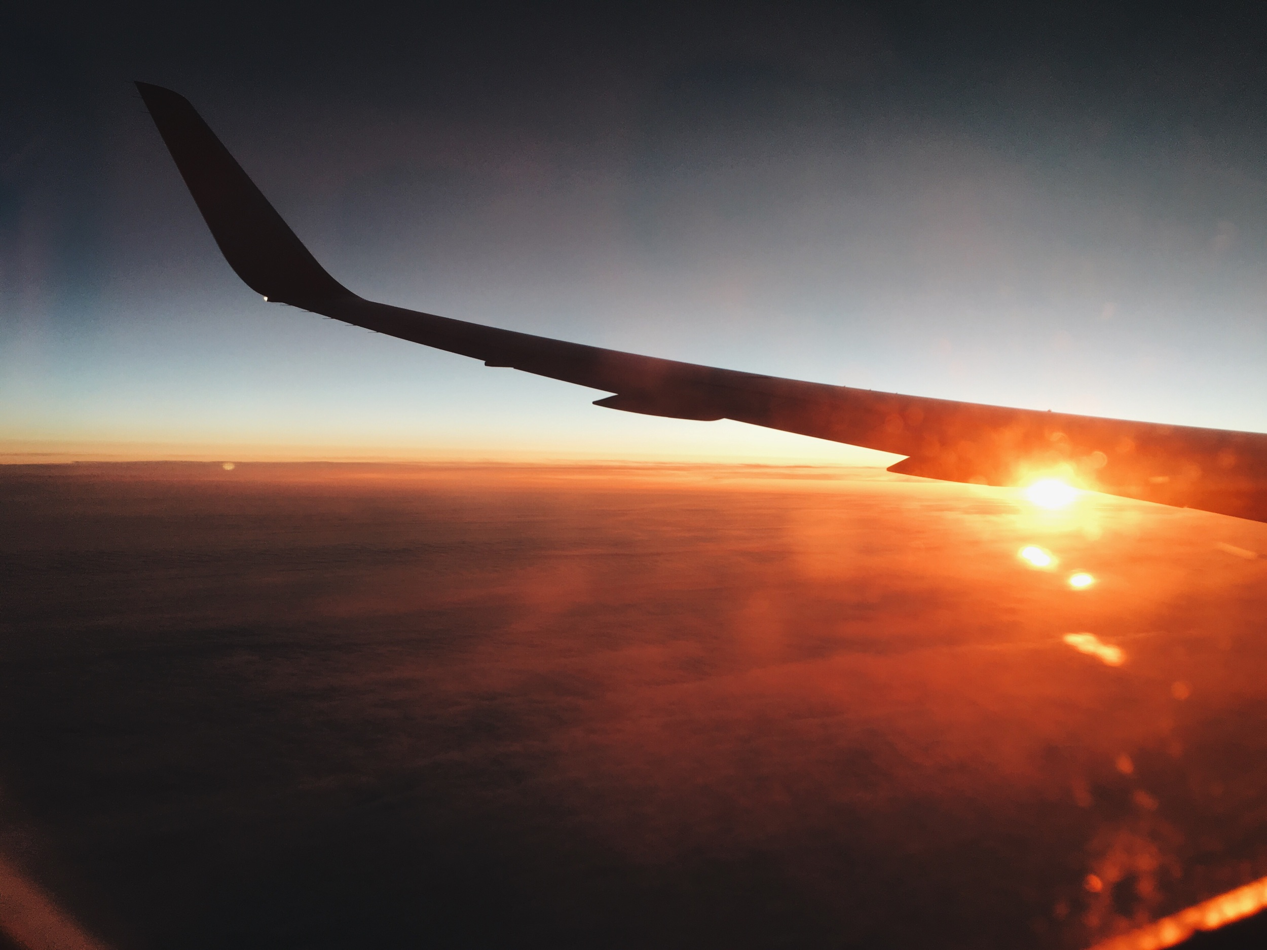 At least when the plane ride is sleepless you can grab shots of the sunrise.
