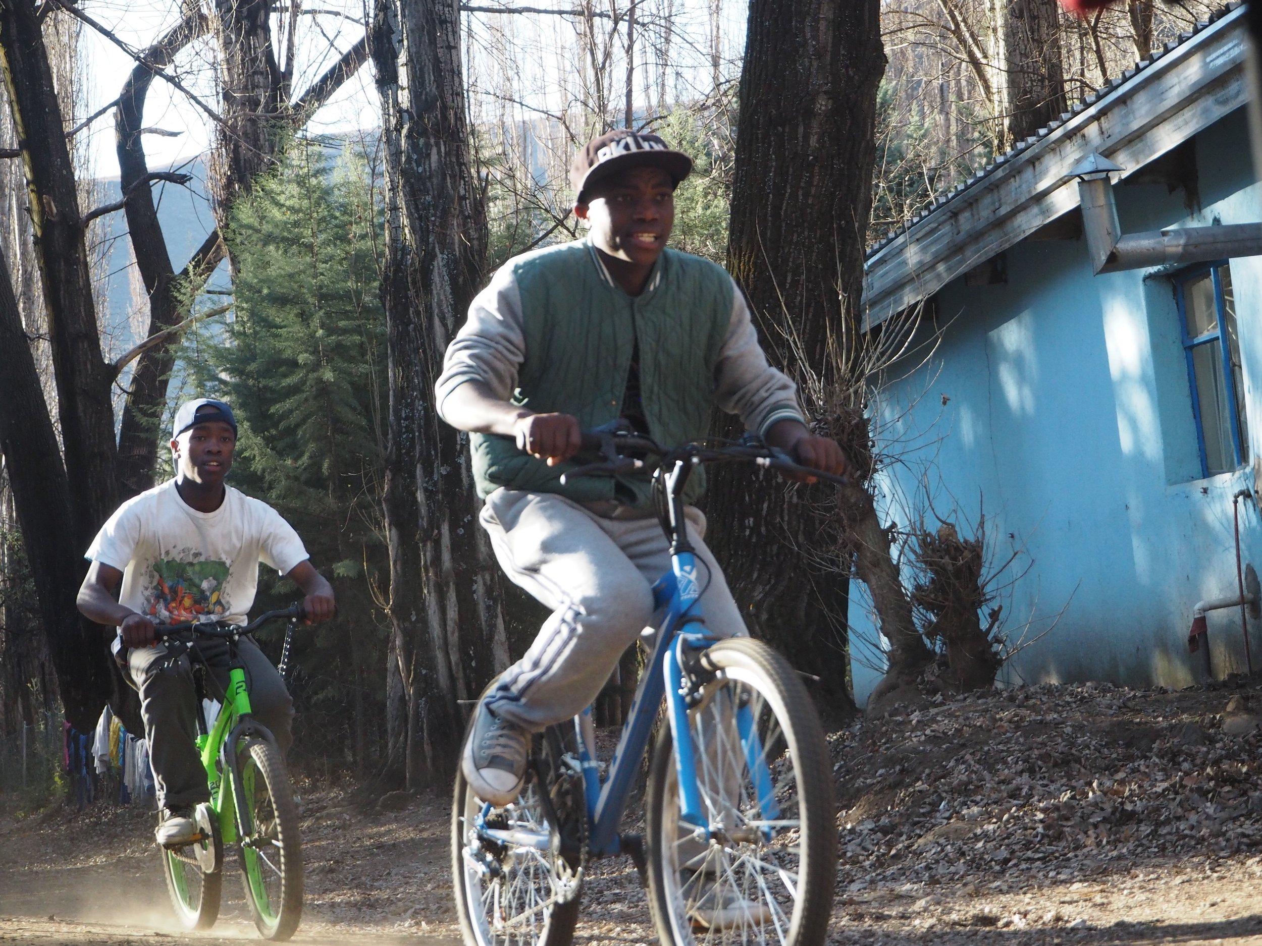 The boys enjoying a Saturday racing bikes