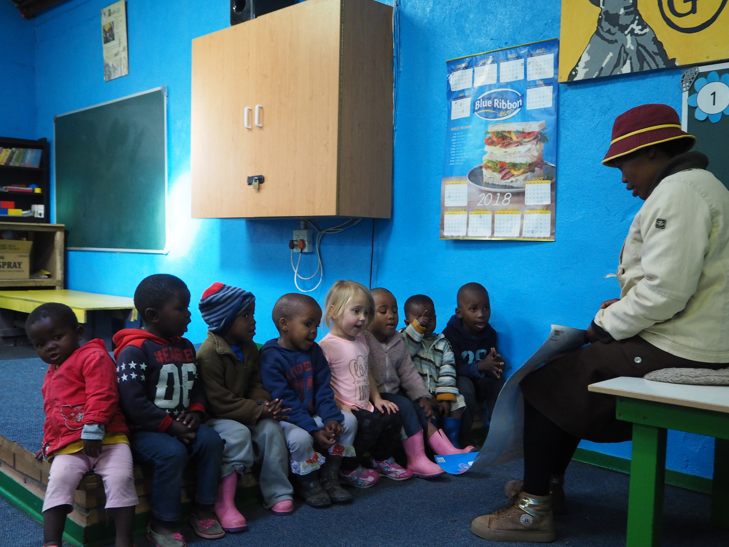 'Me Teresia teaches the preschool group in a freshly painted Wendy House.