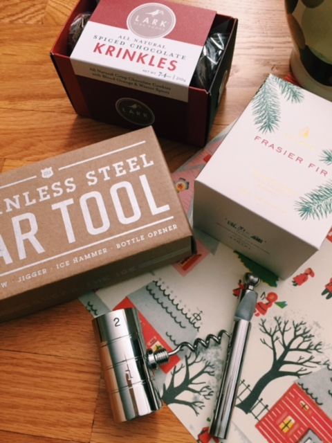 """From Top: Spiced chocolate cookies- aptly named """"Krinkles"""", Large Pour Frasier Fir candle (House Favorite), and a 4 in 1 Stainless bar tool because even the most cocktail savvy will find this handy."""
