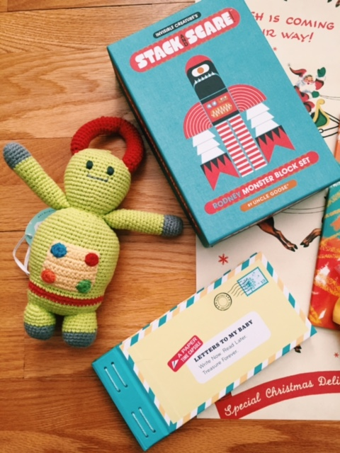 From Left: Knit robot rattle (part of an income generation project), Robot and monster block set, and a book of letters to address to a little one to cherish forever.