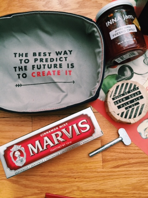 From Top: The foodie favorite  fresno  chili jam, An inspirational catch all valet, Locally crafted beer soap, Italian cinnamon toothpaste and of course a tube key to go with it.
