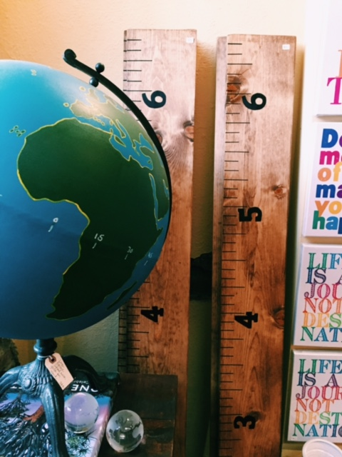 Growth Chart Rulers to mark keepsake heights, created by a local artist.