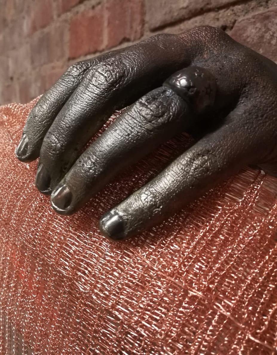Detail of Bronze Hands & Weaving