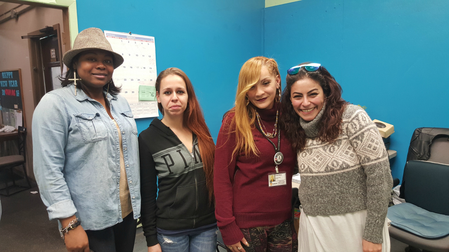 Shanee, jeni, ely and mouna in cumac's food pantry and referral office