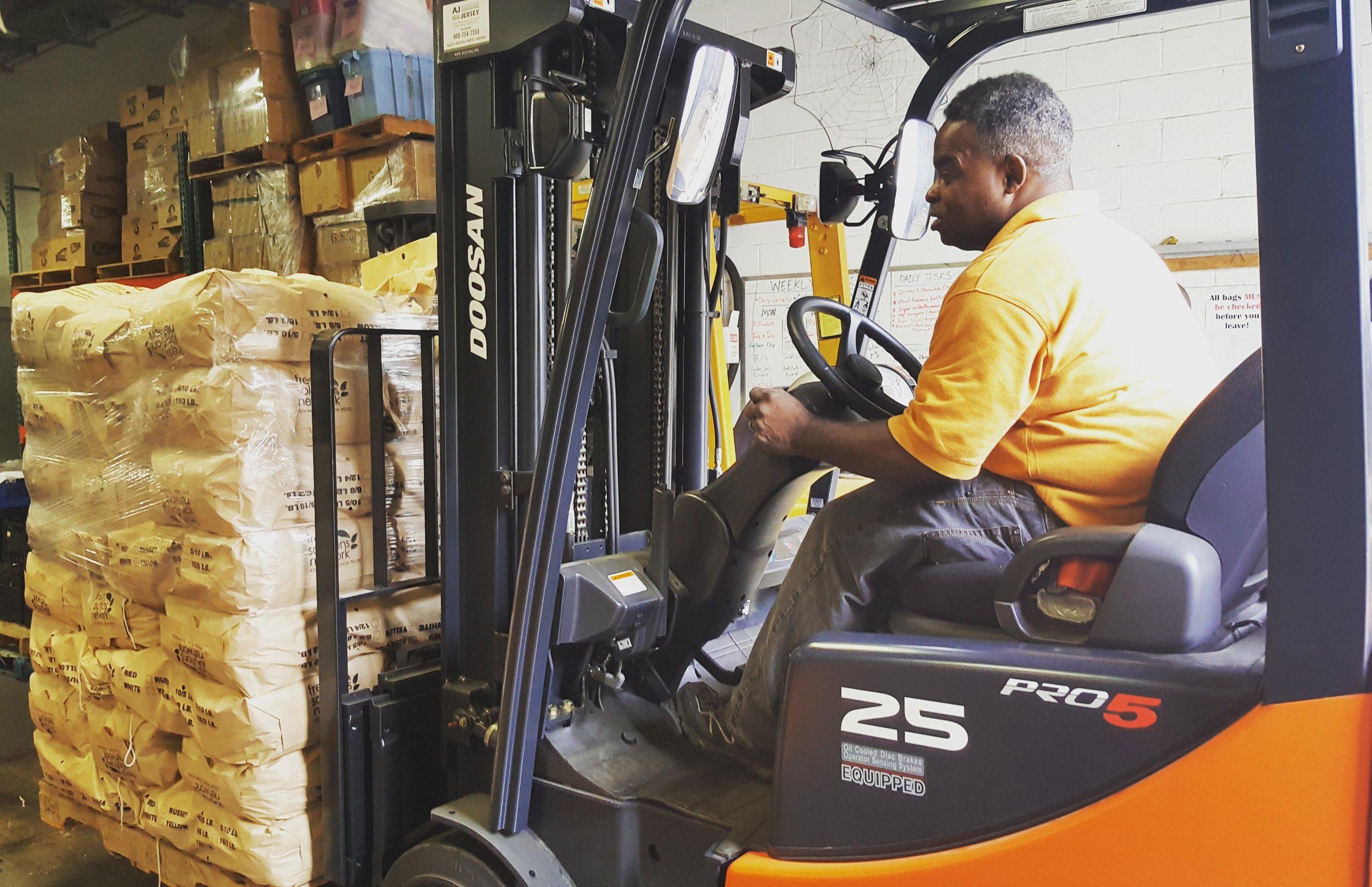 Ernest working in warehouse.jpg