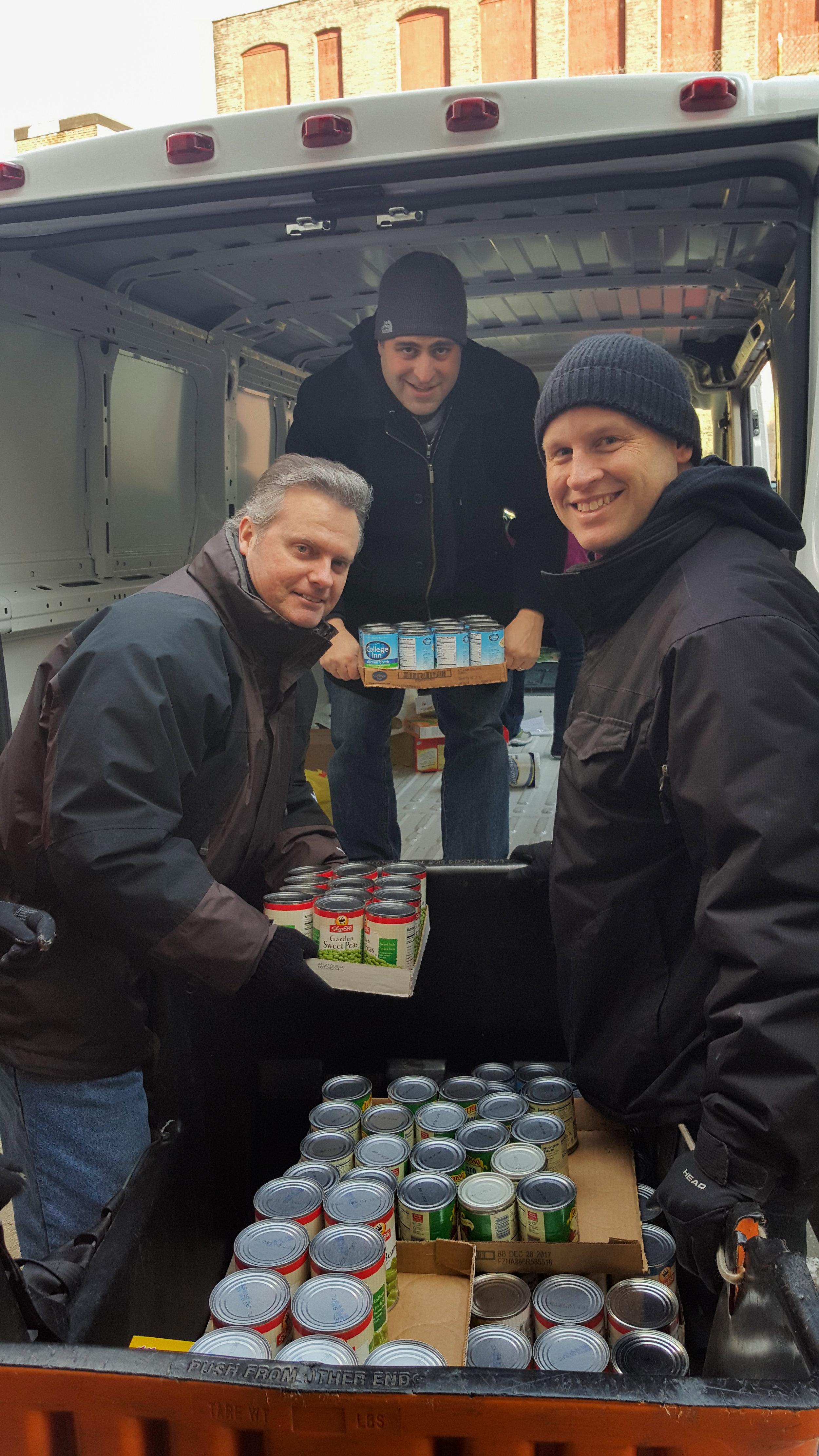 volunteers unloading truck of food.jpg