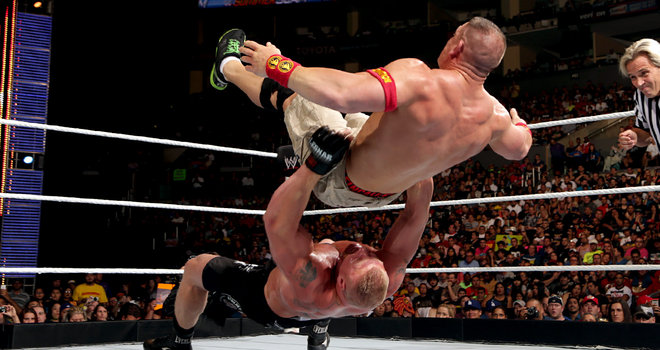 Credit to some guy who got a really good photo of Brock Lesnar dumping John Cena on his big fat stupid head.