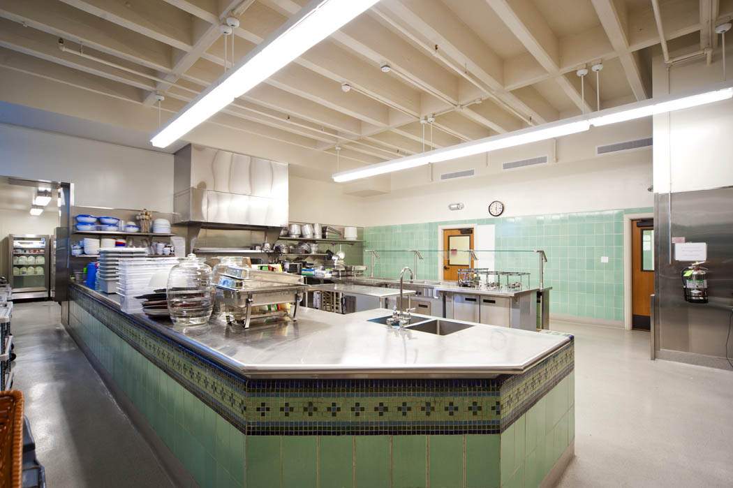 New kitchen at Hilltop High School incorporates an original tile wall from the therapy pool.