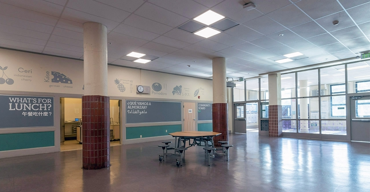 The cafeteria at James Lick Middle School – modernized to bring in more natural light and stronger connection to the campus.