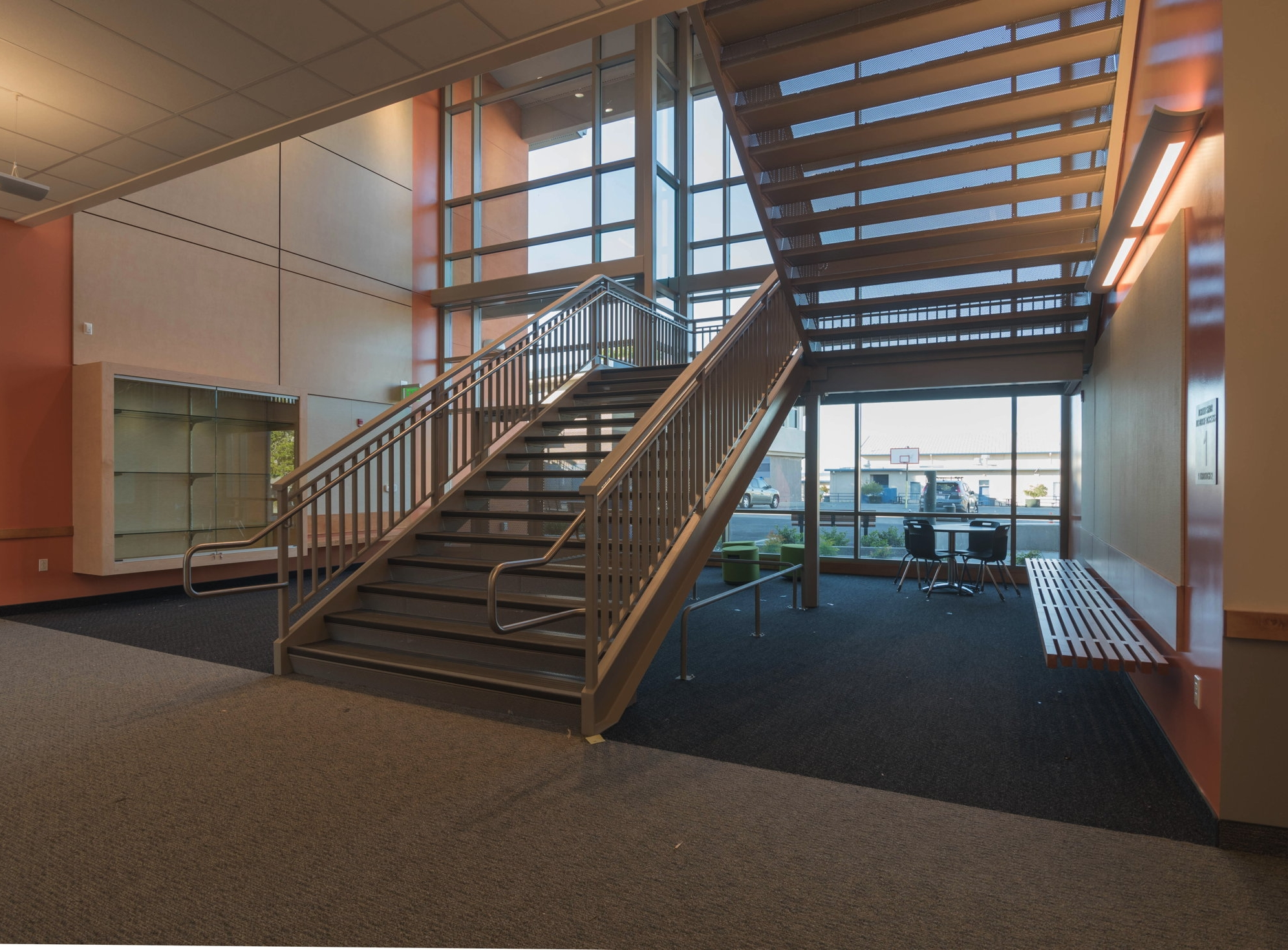 Spaces around the entry lobby and stair are designed as small group learning areas at Burlingame Intermediate School.