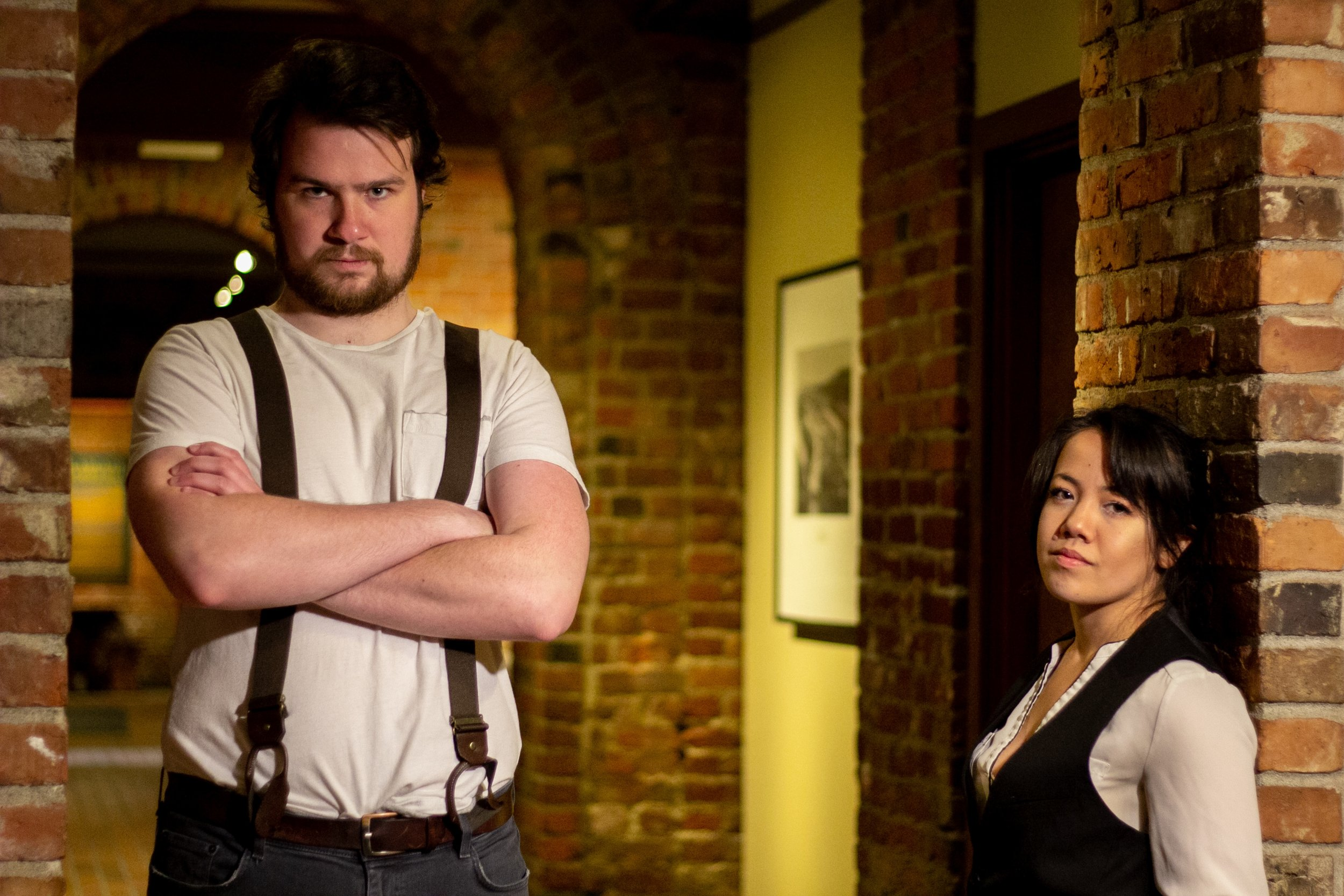 Jordan Moeller (left) and Amber Tanaka (right) as the arsonists Schmitz and Eisenring