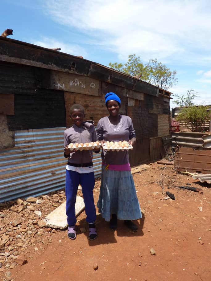 Annie Nkomo and her son, Allen, are egg recipients who live in the Trenance Squatter Camp community. Her husband is bed ridden and she is unemployed. Because of this, she cannot afford school fees for Allen and he had to drop out. Annie helps collect eggs for 5 other families in the Trenance community. She has expressed gratefulness for the eggs as it eases the hunger they face and also helps to provide nutrition and hair regrowth for children receiving antiretroviral treatment (medicine for HIV).