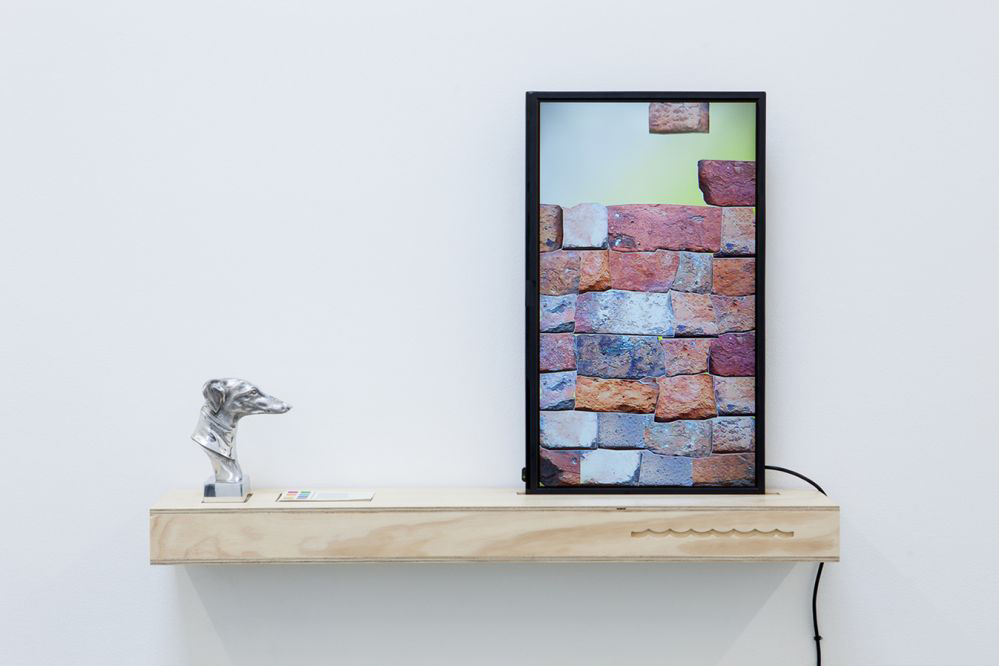 Deep Water @ Sutton Gallery, Speculator part 2, video still on timber shelf and found object, 2016