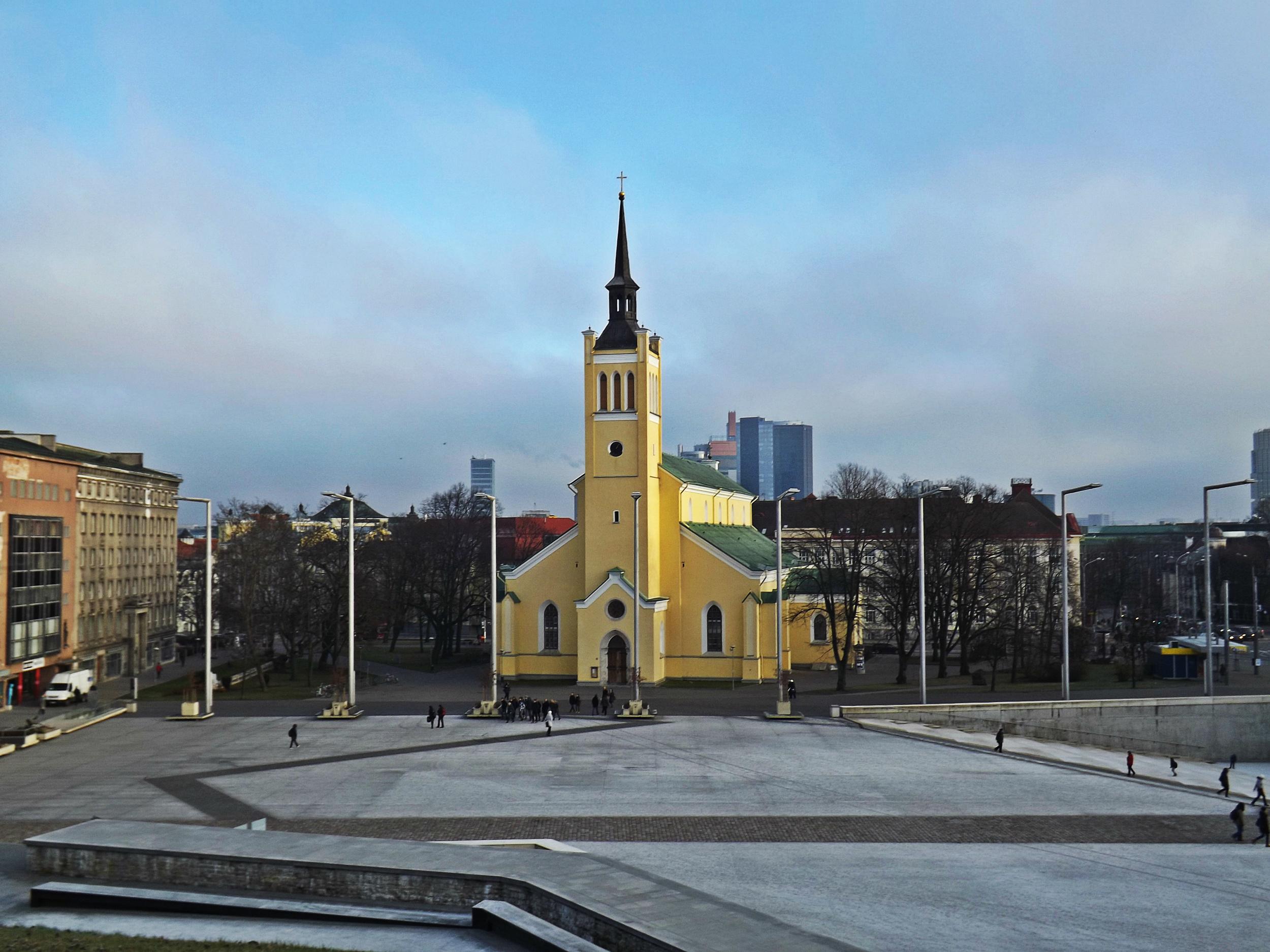 Bright Yellow Tallinn Building | Tall Girl Meets World