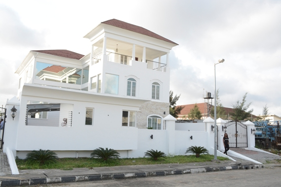 Photo of Linda Ikeji's mansion via her  blog . The 3-floor house includes: 6 en-suite bedrooms, a master suite, 2 living rooms, a cinema room, a gym, and a swimming pool amongst other features.