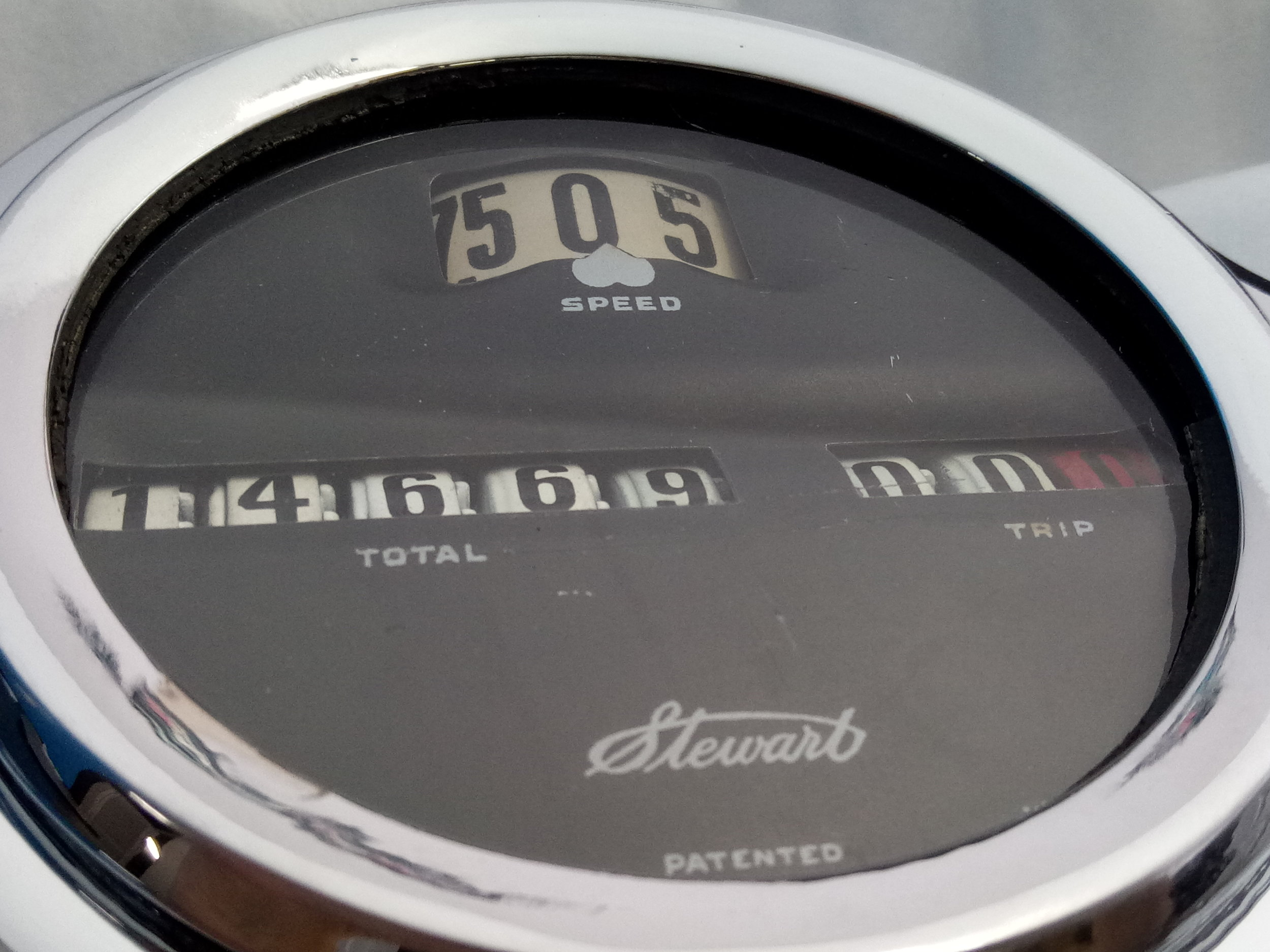 After restoration - new numbers used across speed indicator wheel and odometer