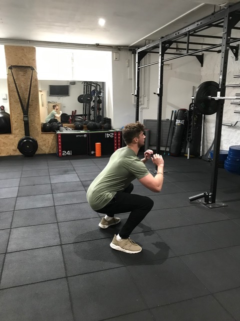 Squat down low, keeping your back straight.