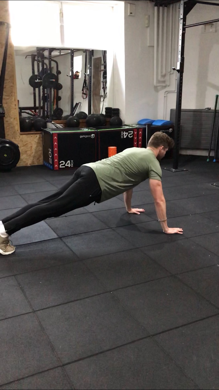 Start in a normal push-up position. Keep your knees on the floor if needed.