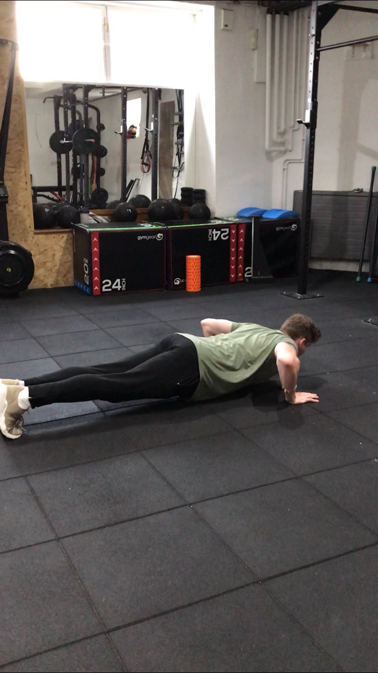 Lower down until your chest is almost touching the floor.