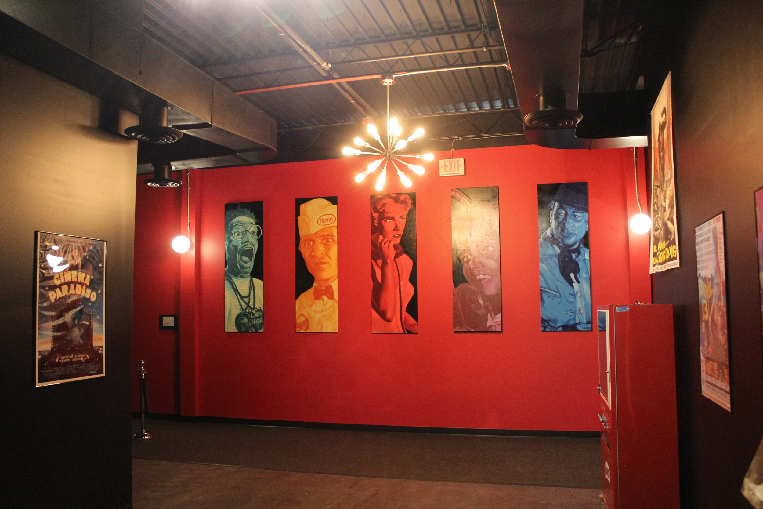 Picture of Wall with Paintings by Gus Cutty of Famous Movie images