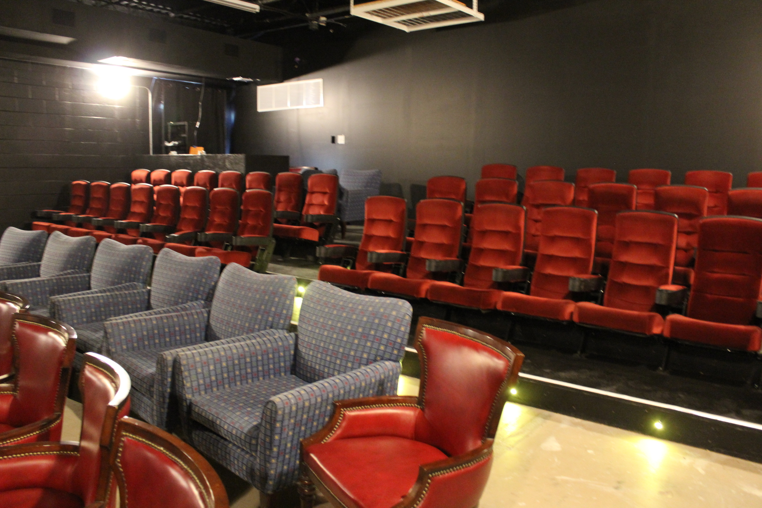 Picture of screen 2 with big blue chairs and theater seats on risers