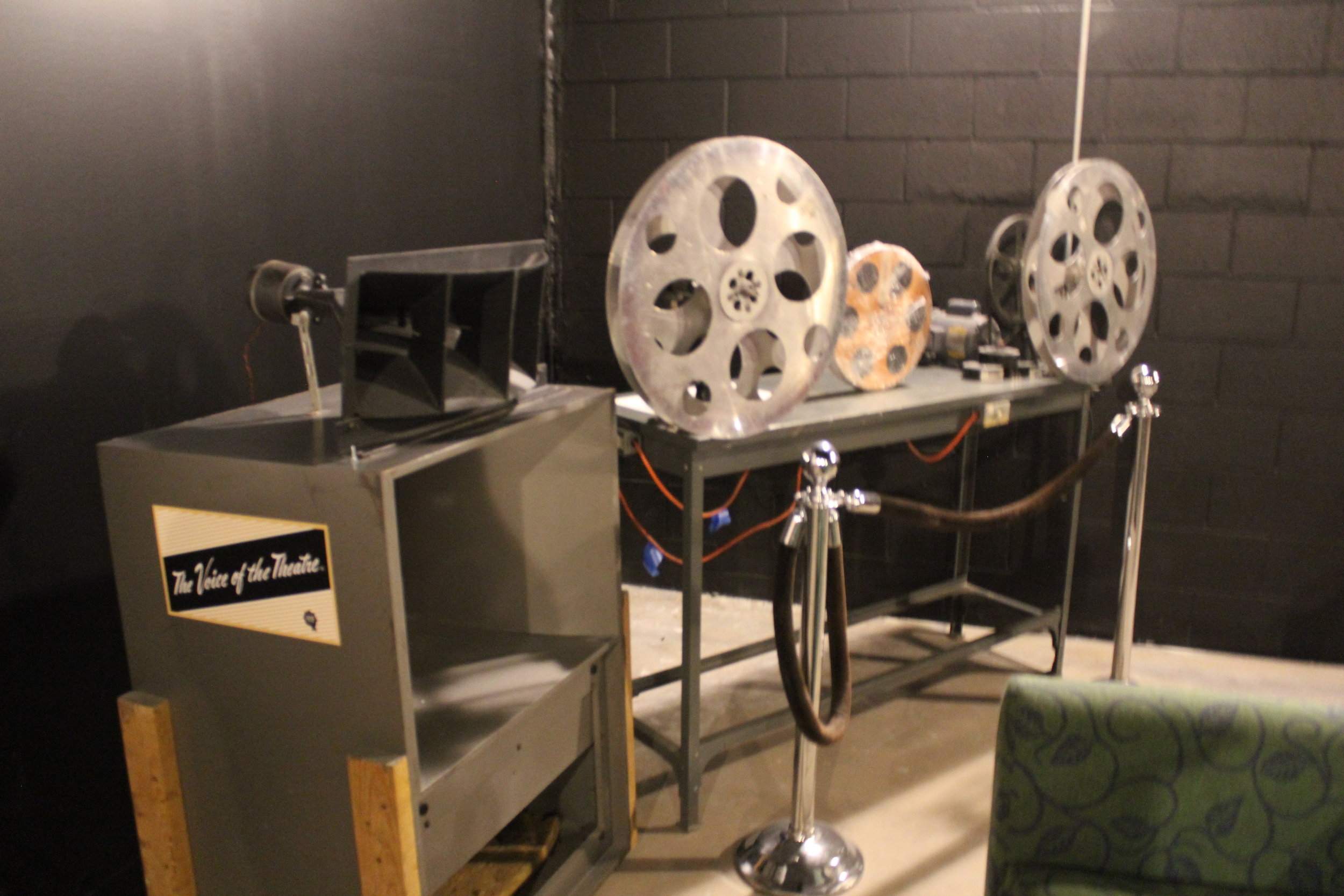 Old editing equipment and movie reels in the corner of screen 2