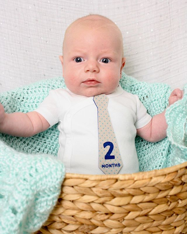 This nugget is two months old!  He is happiest outside, loves to laugh at Mommy's fish faces and his World Peas book!