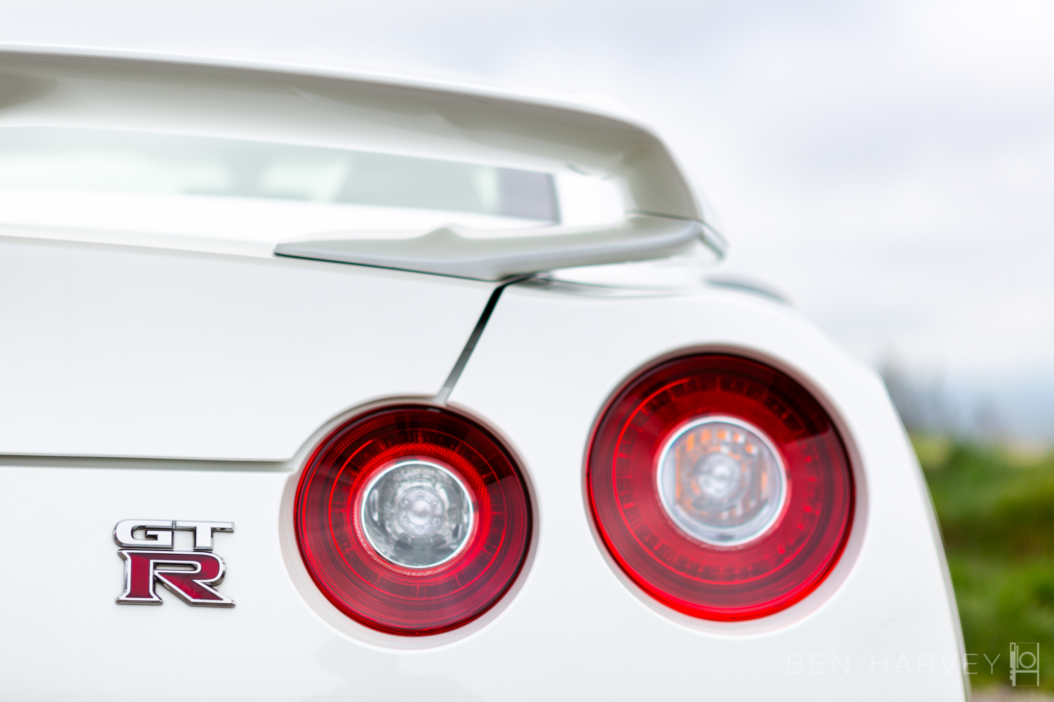 The iconic rear tail lights of a Nissan Skyline