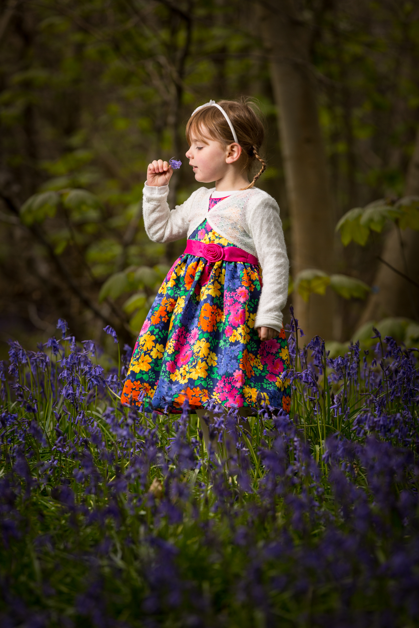 Off camera flash portrait in bluebell woods