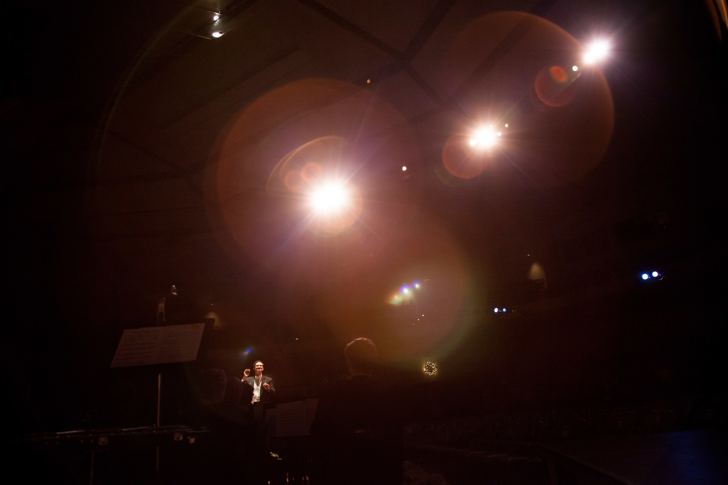 Dr. Alan Hightower conducts in the the stage lights. J.J Abrams, eat your heart out.